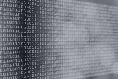 code: binary code and grayscale bokeh gradient, technology and web themed background Stock Photo