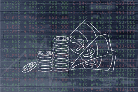 futures: stack of coins and cash on top of stock exchange data Stock Photo