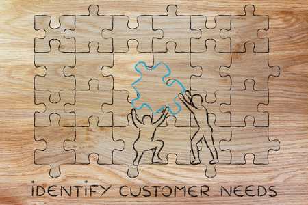 missing piece: identify customer needs: men completing a jigsaw puzzle with the missing piece Stock Photo