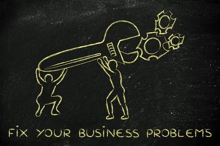 business problems: fix your business problems: men with huge wrench repairing a gearwheel mechanism