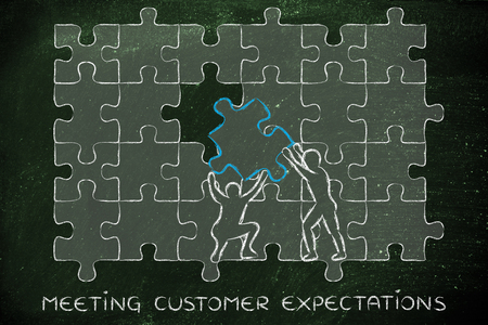 expectations: meeting customer expectations: men completing a jigsaw puzzle with the missing piece Stock Photo