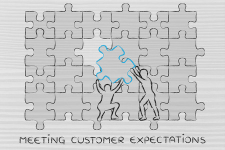 completing: meeting customer expectations: men completing a jigsaw puzzle with the missing piece Stock Photo