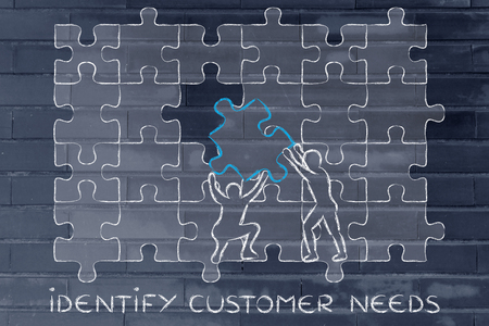 identify customer needs: men completing a jigsaw puzzle with the missing piece Zdjęcie Seryjne
