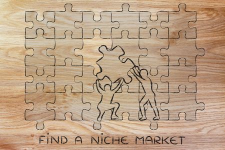 missing piece: find a niche market: men completing a jigsaw puzzle with the missing piece