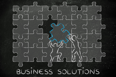 completing: business solutions:  men completing a jigsaw puzzle with the missing piece