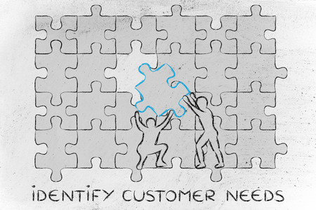 completing: identify customer needs: men completing a jigsaw puzzle with the missing piece Stock Photo