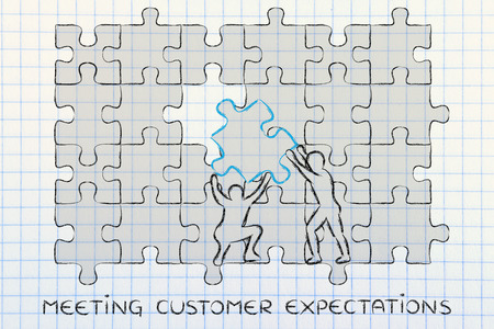 missing piece: meeting customer expectations: men completing a jigsaw puzzle with the missing piece Stock Photo