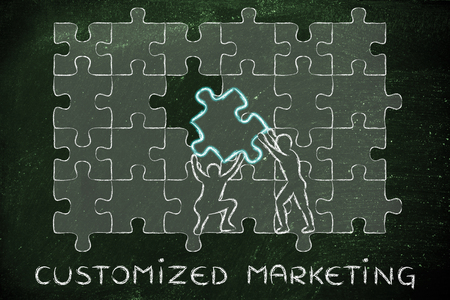 customized: Customized Marketing: metaphor of men completing a puzzle