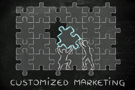 completing: Customized Marketing: metaphor of men completing a puzzle