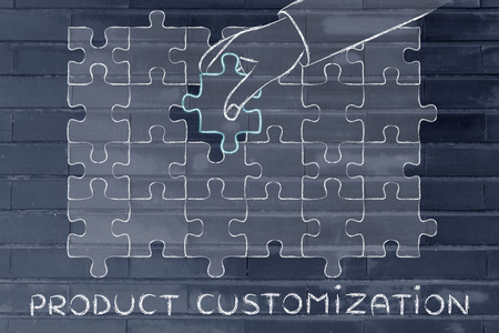 completing: Product Customization: metaphor of hand completing a puzzle