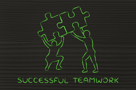 matching: successful teamwork: people lifting up two matching pieces of puzzle