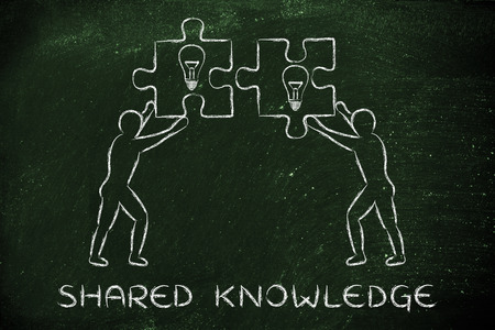 lightbulb: shared knowledge: people about to match two pieces of puzzle with lightbulb sign Stock Photo