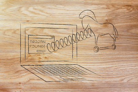 trojan horse coming out of laptop screen with a spring Stock Photo