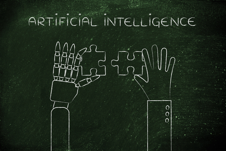 artificial intelligence: human and robot hands solving a puzzle Stock Photo
