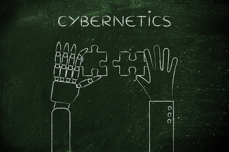 cybernetics: cybernetics: human and robot hands solving a puzzle Stock Photo