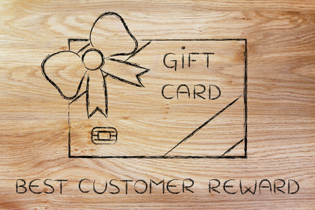 markdown: best customer reward: retailers gift card with wrapping bow Stock Photo