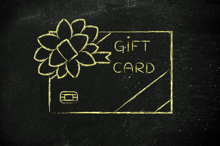 rewarding: retailers gift card with wrapping bow, concept of rewarding clients and free giveaways