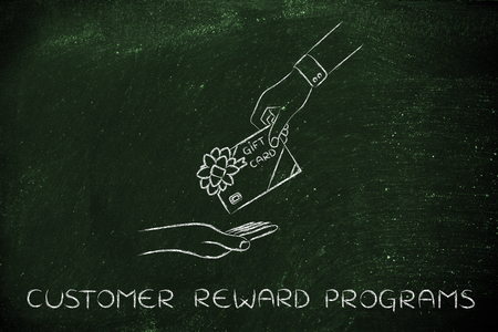 markdown: customer reward programs: hand giving gift card with bow Stock Photo