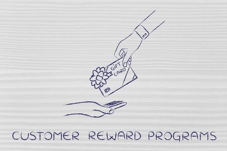 markdown: customer reward programs: hand giving gift card with bow Stock Photo