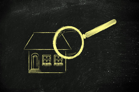 residential market: real estate market and house hunting: magnifying glass analyzing a residential house