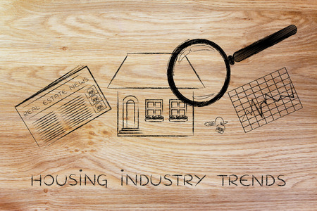 building sector: housing industry trends: magnifying glass analyzing a house, with sector newspaper, stats and keys Stock Photo