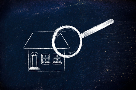 building sector: real estate market and house hunting: magnifying glass analyzing a residential house