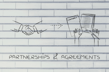 signed: partnerships & agreements: handshake and hands holding signed documents Stock Photo