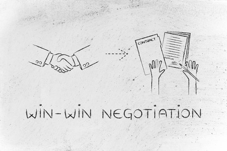 hiring practices: win-win negotiation: handshake and hands holding signed documents