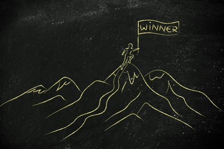 person who reached the top of a mountain holding a Winner banner Stock Photo