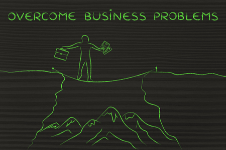 dangerous cliff: overcome business problems: businessman holding business plan and bag tight rope walking over a dangerous cliff