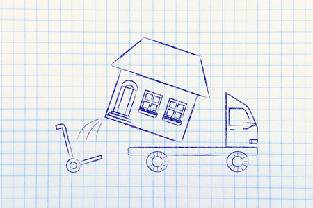 moving truck: loading an entire house on moving company truck, funny metaphor Stock Photo