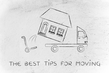 moving company: the best tips for moving: loading an entire house on moving company truck, funny metaphor Stock Photo