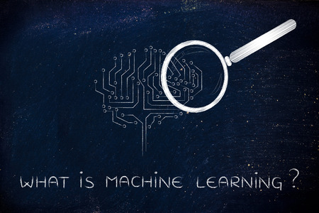 elaboration: what is machine learning: magnifying glass analyzing an electronic circuit brain Stock Photo
