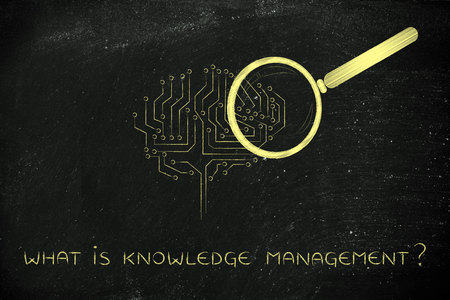 computational: what is knowledgemanagement: magnifying glass Analyzing an electronic brain circuitry Stock Photo