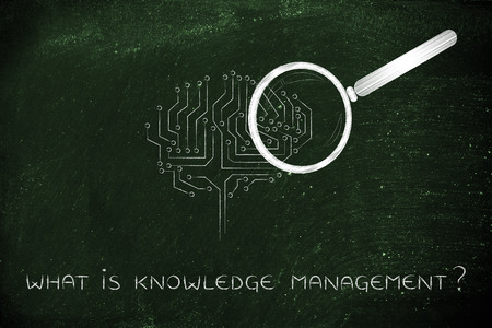 what is knowledgemanagement: magnifying glass Analyzing an electronic brain circuitry Stock Photo