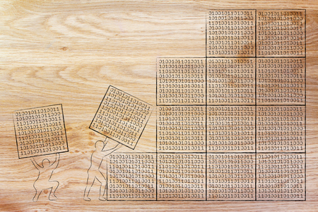 troubleshoot: men lifting blocks with binary code, metaphor illustration about software development and archtecture Stock Photo