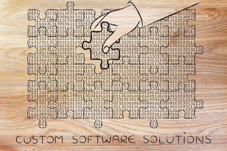 troubleshoot: custom software solutions: hand inserting missing piece of jigsaw puzzle with lines of binary code to fill a gap, metaphor illustration about software development and fixing bugs Stock Photo