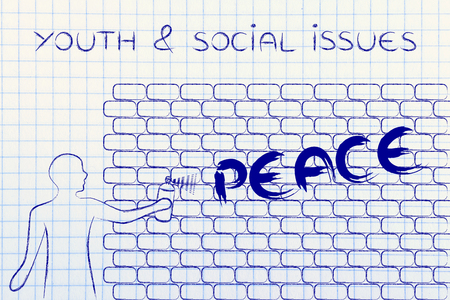 social issues: youth & social issues: person with spray paint writing the word Peace as wall graffiti
