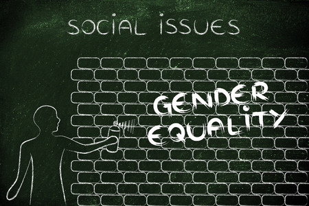 gender equality: person with spray paint writing the word Gender Equality as wall graffiti, social issues theme
