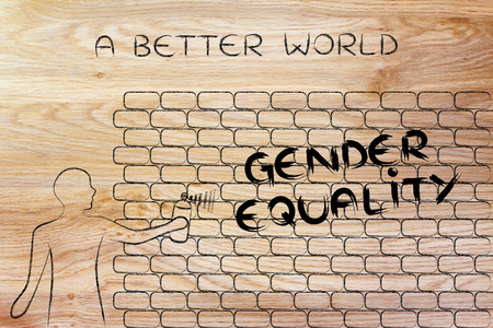 gender equality: person with spray paint writing the word Gender Equality as wall graffiti, a better world