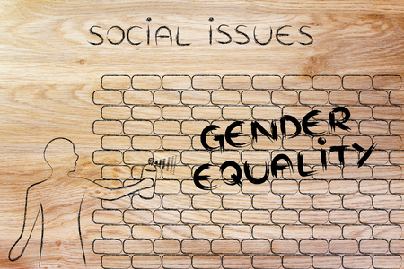 person with spray paint writing the word Gender Equality as wall graffiti, social issues theme