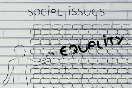 person writing: person with spray paint writing the word Equality as wall graffiti, social issues theme Stock Photo