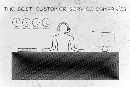 the best customer service companies: employee with headphones working at his desk Stock Photo