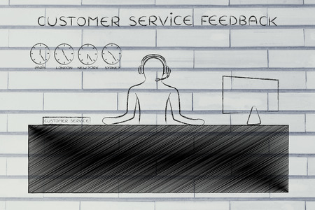customer service feedback: employee with headphones working at his desk Stock Photo