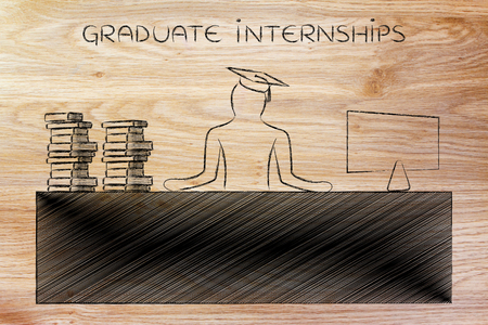 internships: graduate internships: person with graduation hat and pile of book sitting at office desk with computer