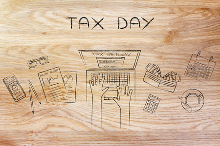 tax day: tax return website on users laptop screen and desk with income report documents, wallet, calendar and calculator