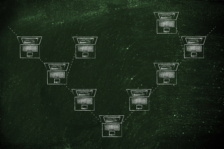 network topology: laptops connected with each other in a tree network structure Stock Photo