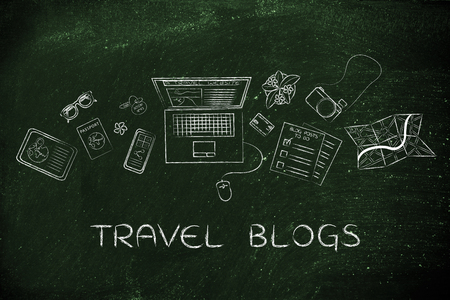 globetrotter: travel blogs: desk with mixed travel & lifestyle objects and personal blog website on laptops screen Stock Photo