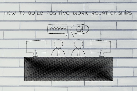 agreeing: how to build positive work relationships: colleagues at office desk agreeing with each other