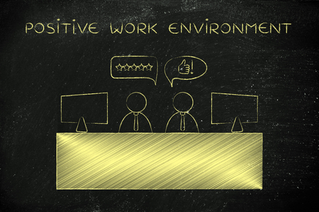 work environment: positive work environment: colleagues at office desk agreeing with each other